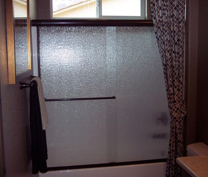 Tub Enclosure with Rain Glass in Bronze Finish & Atlas Shower Doors